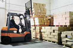 Forklift loader in warehouse Stock Image