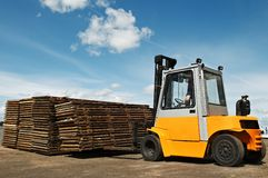Forklift loader at warehouse works Royalty Free Stock Images