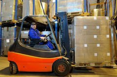 Forklift loader worker at warehouse Royalty Free Stock Photo