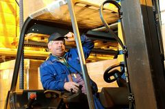Forklift loader worker at warehouse Royalty Free Stock Photos