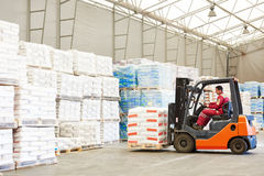 Forklift loader working in warehouse Royalty Free Stock Image