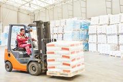 Forklift loader working in warehouse Stock Image