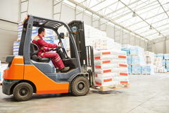 Forklift loader working in warehouse Stock Images