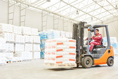 Forklift loader working in warehouse Royalty Free Stock Images