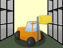 Forklift loader works in warehouse. Forklift loader puts the big box on storage shelves Royalty Free Stock Images