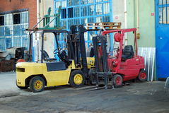 Forklift. Loaders parking front of warehouse stock photo