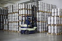 Forklift loading beer kegs in stock brewery Ochakovo Stock Photo