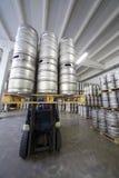 Forklift loading beer kegs in stock brewery Ochakovo Stock Photography