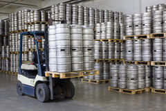 Forklift loading beer kegs Stock Photography