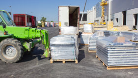 Forklift loading pallets. In warehouse Royalty Free Stock Photography