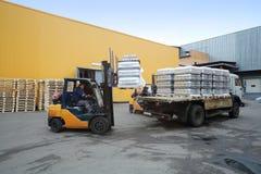 Forklift loading pallets of beer bottles on the truck Stock Photo