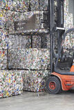 Forklift Loading Stacks Of Recycled Products Royalty Free Stock Photo