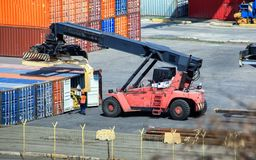 Forklift loads business wood container at container terminals. stock photo