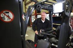 Forklift mechanic Royalty Free Stock Photo