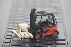 Forklift with new email graphic on wooden block over laptop keyboard stock images