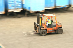 Forklift in motion Stock Photography