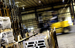 Forklift moving in factory Royalty Free Stock Photos