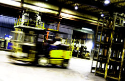Forklift moving in factory Stock Photo
