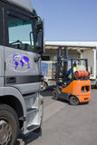 Forklift moving inventory on loading dock Royalty Free Stock Photography