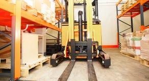 Forklift, odkłada i dręczy z barłogami Fotografia Stock