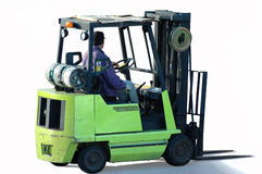 Forklift and Operator. A man operating a forklift Stock Photos