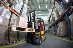 Free Forklift Operator At Work In Warehouse Stock Photos - 14827263