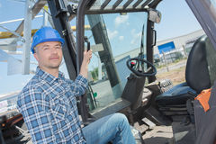 Forklift operator on site Stock Photography