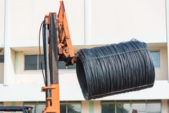 Forklift pick up wire coil Royalty Free Stock Image