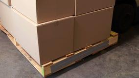 Forklift picking up palette of boxes