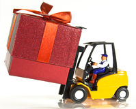 Forklift and present Royalty Free Stock Photography