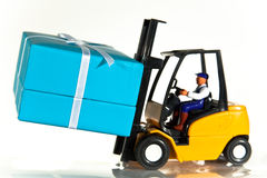 Forklift and present Royalty Free Stock Image
