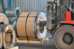 Forklift with rolls of steel sheet. Close up Royalty Free Stock Image
