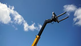Forklift head. Forklift`s head against blue sky royalty free stock photos
