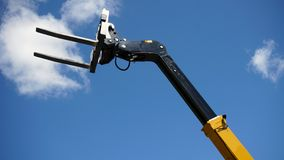 Forklift head. Forklift`s head against blue sky stock image