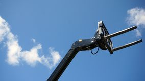 Forklift head. Forklift`s head against blue sky stock photo