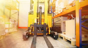 Forklift, shelves and racks with pallets. In distribution warehouse interior Royalty Free Stock Image
