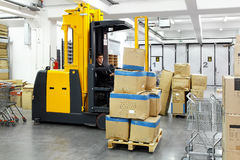 Forklift stacker. Electric forklift stacker in warehouse with boxes Stock Image