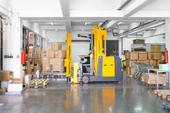 Forklift stacker. Electric forklift stacker moving boxes in warehouse Stock Photo