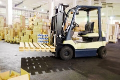 Forklift stacker in warehouse Royalty Free Stock Photography