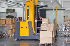 Forklift. Stacker in Warehouse With Boxes at Pallet Stock Photos