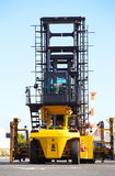 Forklift is stacking container Stock Images