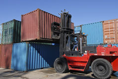 Forklift stacking containers Royalty Free Stock Images