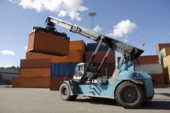 Forklift stacking containers Royalty Free Stock Image