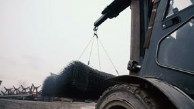 The Forklift Takes Load with Metal Net stock video