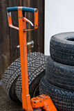 Forklift and tires. A forklift used for stacking winter tires at a garage Royalty Free Stock Photo