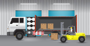 Forklift. Transfer cartons into truck with factory background Royalty Free Stock Photos