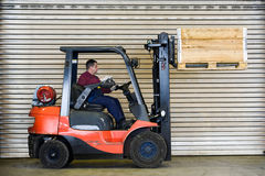 Forklift Transport A Wooden Box Royalty Free Stock Images