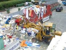 Forklift in transportation of garbage stock image