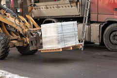 Forklift transports the pallet with the load Stock Photos