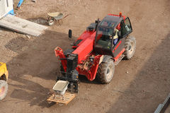 Forklift Truck. Truck mounted forklift, carrying a wheelbarrow with cement stock photography